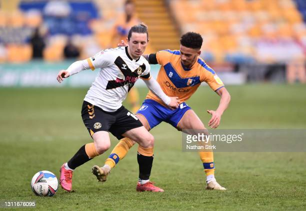 Aaron Lewis of Newport County is challenged by Tyrese Sinclair of Mansfield Town during the Sky Bet League Two match between Mansfield Town and...