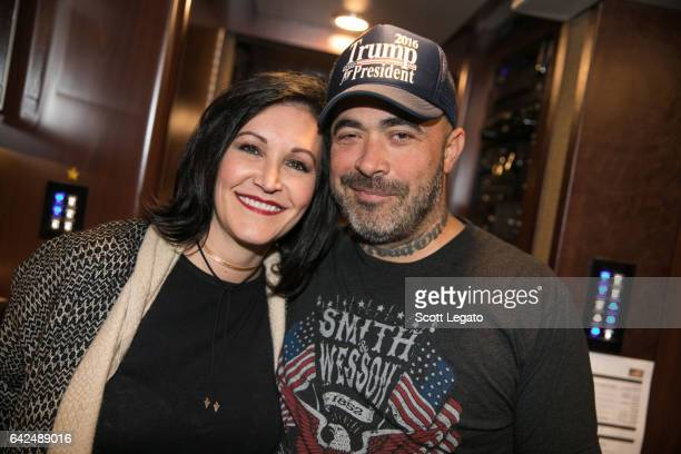Aaron Lewis poses with fan Amy Legato backstage at The Fillmore on February 17 2017 in Detroit Michigan