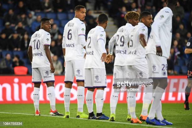 Aaron Leya Iseka and team of Toulouse during the Ligue 1 match between Paris Saint Germain and Toulouse at Parc des Princes on November 24 2018 in...