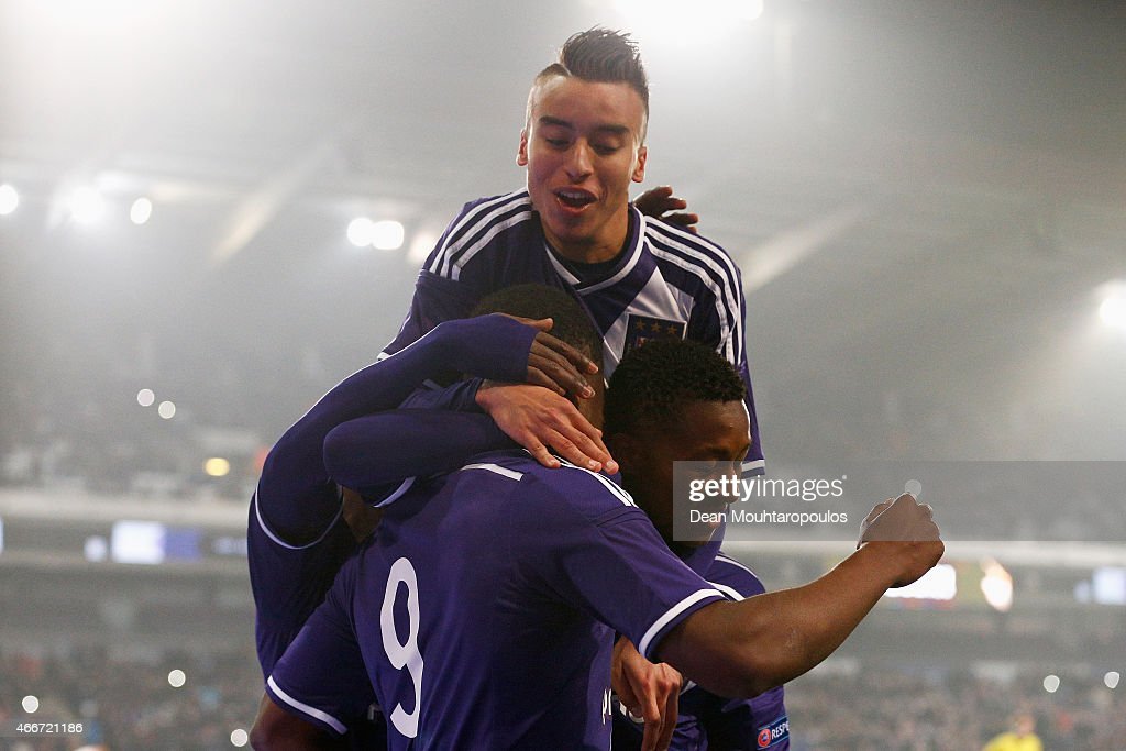Aaron Leya Iseka #9 of Anderlecht celebrates scoring a goal from the penalty spot completing his hat trick with team mate Samuel Bastien and Bilal Jellal during the UEFA Youth League quarter final match between RSC Anderlecht and FC Porto at Constant Vanden Stock Stadium on March 18, 2015 in Brussels, Belgium.