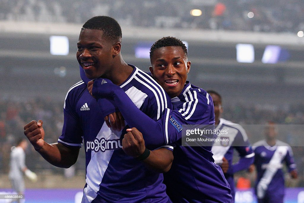 Aaron Leya Iseka (L) of Anderlecht celebrates scoring a goal from the penalty spot completing his hat trick with team mate Samuel Bastien during the UEFA Youth League quarter final match between RSC Anderlecht and FC Porto at Constant Vanden Stock Stadium on March 18, 2015 in Brussels, Belgium.
