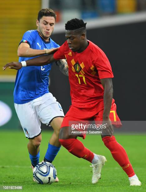 Aaron Leya Iseka of Belgium U21 competes for the ball with Davide Calabria of Italy U21 during the International Friendly match between Italy U21 and...