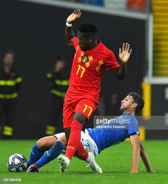 Aaron Leya Iseka of Belgium U21 competes for the ball with Manuel Locatelli of Italy U21 during the International Friendly match between Italy U21...