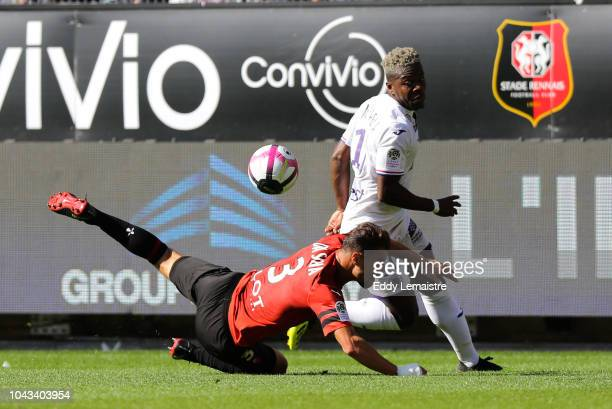 Aaron Leya Iseka of Toulouse and Damien Da Silva of Rennes during the Ligue 1 match between Rennes and Toulouse at Roazhon Park on September 30 2018...