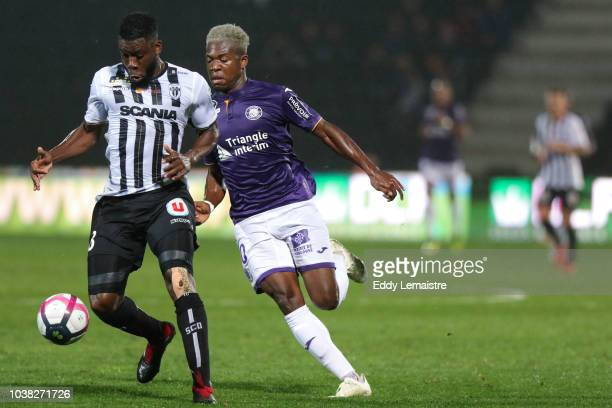 Aaron Leya Iseka of Toulouse and Ismael Traore of Angers during the Ligue 1 match between Angers and Toulouse at Stade Jean Bouin on September 22...