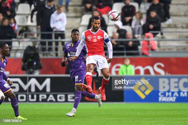 Aaron Leya Iseka of Toulouse and Jacques Alaixys Romao of Reims during the Ligue 1 match between Stade de Reims and Toulouse FC on December 5 2018 in...