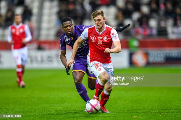 Aaron Leya Iseka of Toulouse and Thomas Foket of Reims during the Ligue 1 match between Stade de Reims and Toulouse FC on December 5 2018 in Reims...