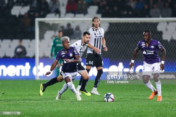 Aaron Leya Iseka of Toulouse and Thomas Mangani of Angers during the Ligue 1 match between Angers and Toulouse at Stade Jean Bouin on September 22...