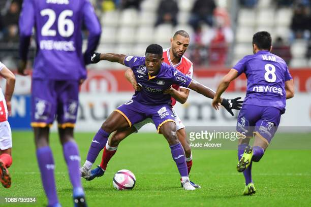 Aaron Leya Iseka of Toulouse and Yunis Abdelhamid of Reims during the Ligue 1 match between Stade de Reims and Toulouse FC on December 5 2018 in...