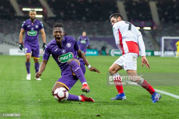 Aaron Leya Iseka of Toulouse is fouled by Xavier Chavalerin of Reims during the Toulouse FC V Stade de Reims Coupe de France match at the Stadium...