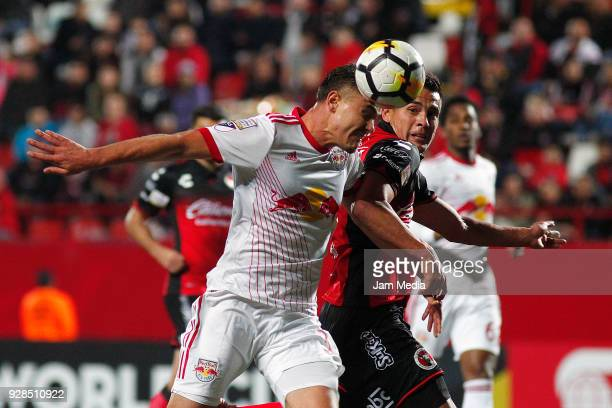 Aaron Long of New York Bulls fights for the ball with Rubio Rubin of Tijuana during the quarter finals first leg match between Tijuana and New York...