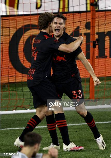 Aaron Long of New York Red Bulls celebrates his goal with teammate Tom Barlow during the second half against the New England Revolution at Red Bull...
