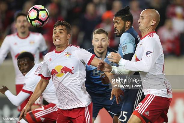 Aaron Long of New York Red Bulls in action watched by Sheanon Williams of Vancouver Whitecaps and Aurelien Collin of New York Red Bulls during the...
