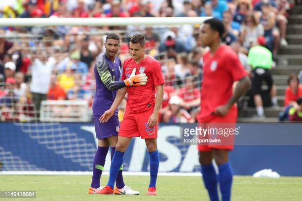 Aaron Long of the United States looks on after Zack Steffen of the United States is unable to stop the ball for a goal scored by Jose Salomon Rondon...