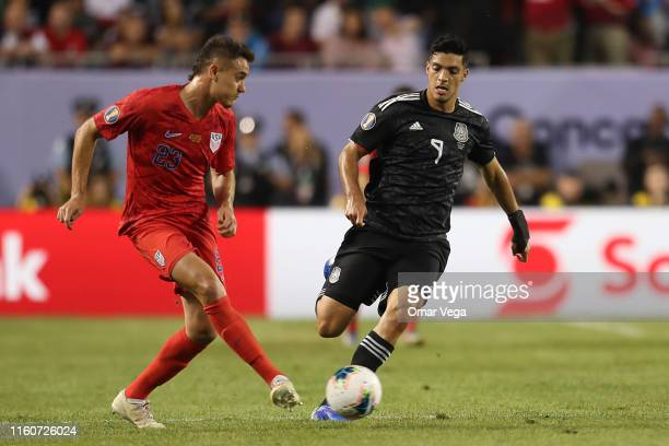 Aaron Long of United States and Raul Jimenez of Mexico fight the ball during the CONCACAF Gold Cup 2019 final match between United States and Mexico...