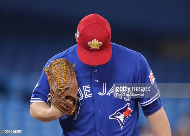 Aaron Loup of the Toronto Blue Jays gets set on the mound before pitching in the seventh inning during MLB game action against the New York Mets at...