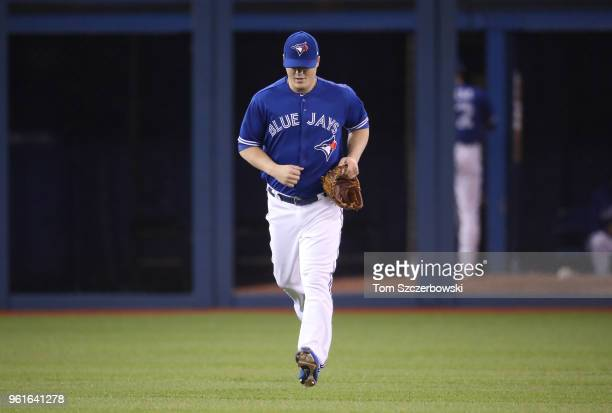 Aaron Loup of the Toronto Blue Jays jogs in from the bullpen during a pitching change in the eighth inning during MLB game action against the Oakland...