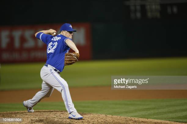 Aaron Loup of the Toronto Blue Jays pitches during the game against the Oakland Athletics at the Oakland Alameda Coliseum on July 30 2018 in Oakland...