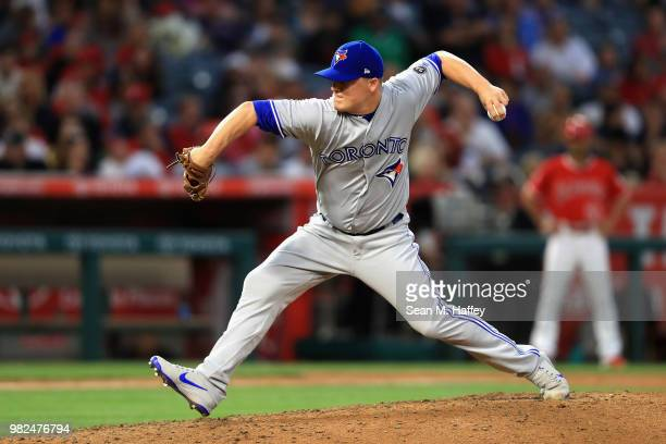 Aaron Loup of the Toronto Blue Jays pitches during the sixth inning of a game against the Los Angeles Angels of Anaheim at Angel Stadium on June 23...