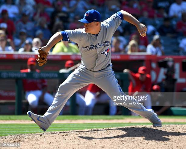 Aaron Loup of the Toronto Blue Jays pitches in the game against the Los Angeles Angels of Anaheim at Angel Stadium on June 24 2018 in Anaheim...