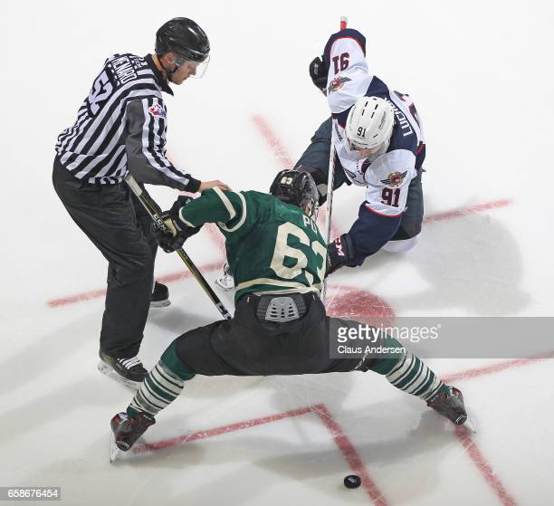 Aaron Luchuk of the Windsor Spitfires takes a faceoff against Cliff Pu of the London Knights during Game Two of the OHL Western Conference Quarter...