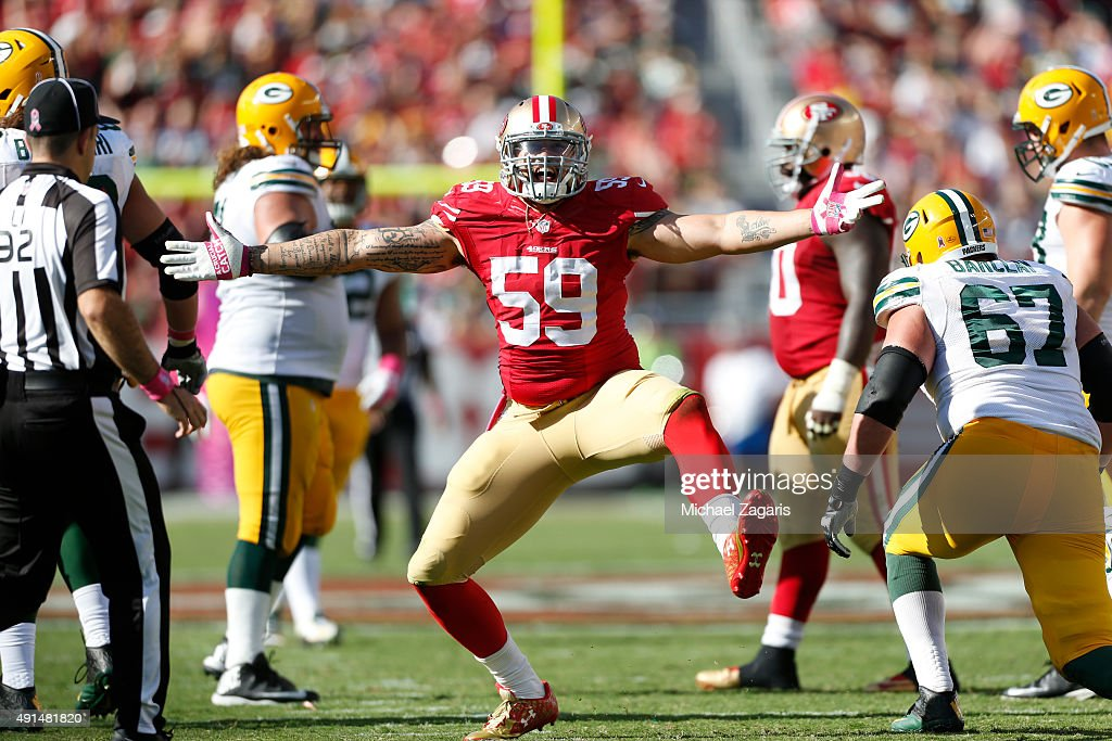 Aaron Lynch #59 of the San Francisco 49ers celebrates after sacking Aaron Rodgers #12 of the Green Bay Packers during the game at Levi Stadium on October 4, 2015 in Santa Clara, California. The Packers defeated the 49ers 17-3.