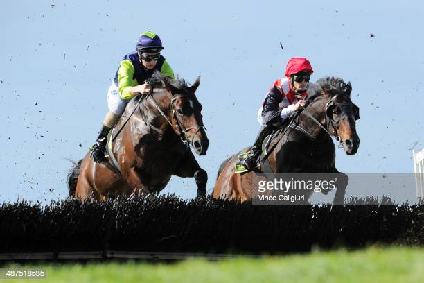 Aaron Lynch riding Take Out and Rowan Waymouth riding Frogsplash jump the second last hurdle in Race 1 the Hammonds Hurdle during the Warrnambool May...
