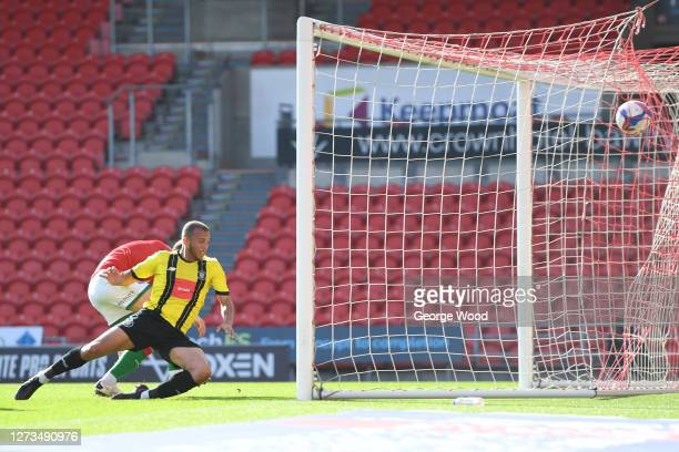 Aaron Martin of Harrogate Town scores his sides first goal during the Sky Bet League Two match between Harrogate Town and Walsall at The Keepmoat...