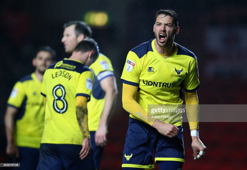 Aaron Martin of Oxford argues with the linesman during the EFL Checkatrade Trophy Third Round match between Charlton Athletic and Oxford United at The Valley on January 9, 2018 in London, England.