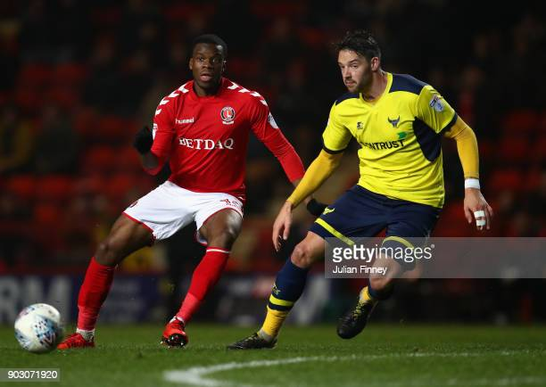 Aaron Martin of Oxford battles with Stephy Mavididi of Charlton during the EFL Checkatrade Trophy Third Round match between Charlton Athletic and...