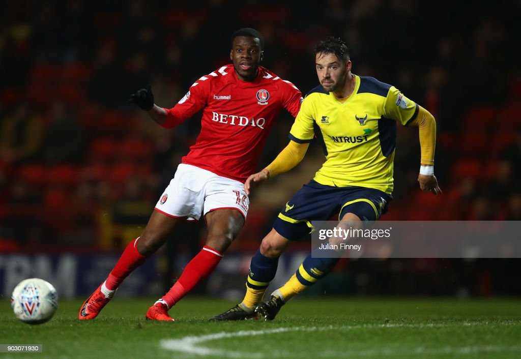 Aaron Martin of Oxford battles with Stephy Mavididi of Charlton during the EFL Checkatrade Trophy Third Round match between Charlton Athletic and Oxford United at The Valley on January 9, 2018 in London, England.