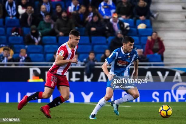 Aaron Martin of RCD Espanyol controls the ball under pressure from Pablo Maffeo of Girona FC during the La Liga match between RCD Espanyol and Girona...