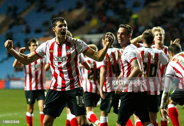 Aaron Martin of Southampton celebrates with teammates after scoring his side's second goal during the FA Cup 3rd round match between Coventry City...