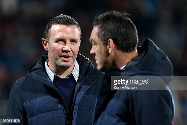 Aaron Mauger head coach of the Highlanders and Mark Hammett assistant coach of the Highlanders look on ahead of the round 18 Super Rugby match...