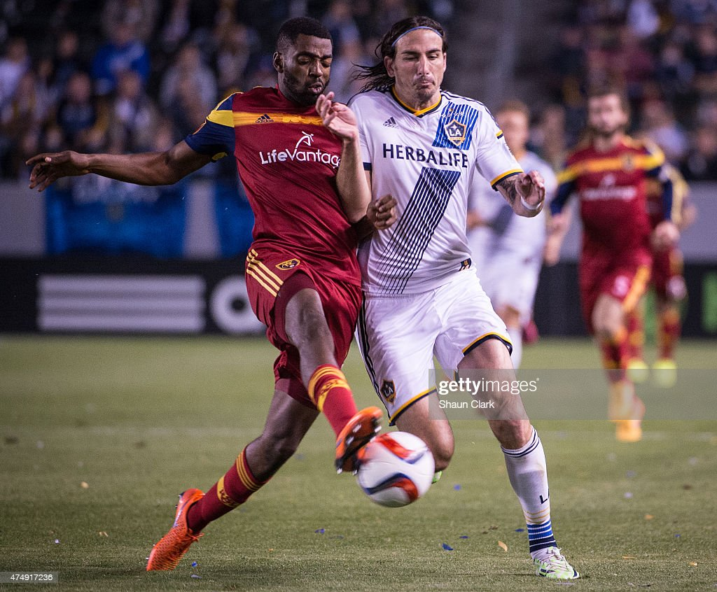 Aaron Maund (21) of Real Salt Lake cuts off Alan Gordon (9) of Los Angeles Galaxy during Los Angeles Galaxy's match against Real Salt Lake at the Stubhub Center on May 27, 2015 in Carson, California. The LA Galaxy won the match 1-0.