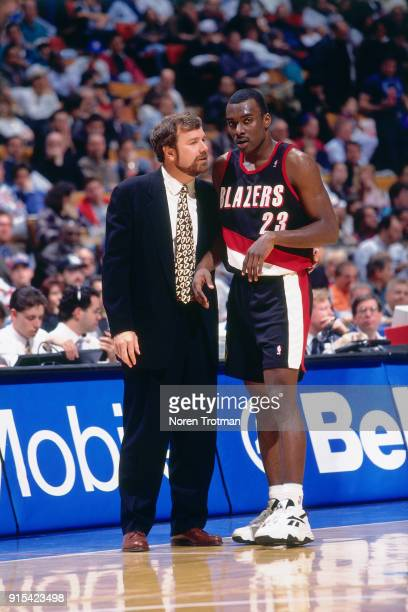 Aaron McKie and PJ Carlesimo of the Portland Trail Blazers talk during a game played on March 30 1995 at Continetal Airlines Arena in East Rutherford...