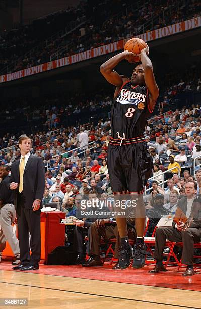 Aaron McKie of the Philadelphia 76ers shoots against the Atlanta Hawks during the game at Philips Arena on April 6 2004 in Atlanta Georgia The 76ers...