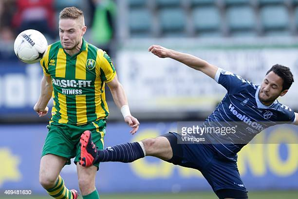 Aaron Meijers of ADO Den Haag Mark van der Maarel of FC Utrecht during the Dutch Eredivisie match between ADO Den Haag and FC Utrecht at Kyocera...