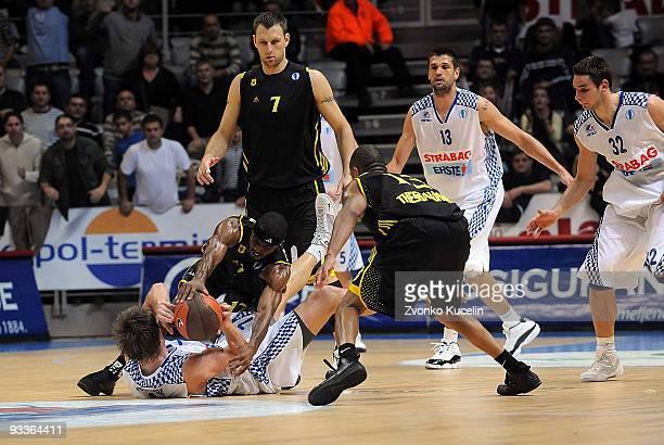 Aaron Miles #17 of Aris BSA 2003 competes with Vladimir Boisa #7 of KK Zadar during the Eurocup Basketball Regular Season 20092010 Game Day 1 between...
