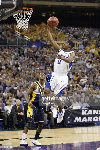Aaron Miles of University of Kansas Jayhawks goes for a layup during the semifinal round of the NCAA Final Four Tournament against Marquette...