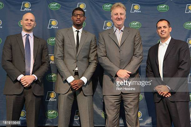 Aaron Mintz George's Agent Paul George Larry Bird the President of Basketball Operations and Frank Vogel head coach of the Indiana Pacers pose for a...