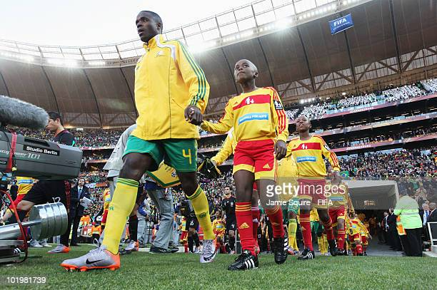 Aaron Mokoena of South Africa enters the pitch prior to the 2010 FIFA World Cup South Africa Group A match between South Africa and Mexico at Soccer...
