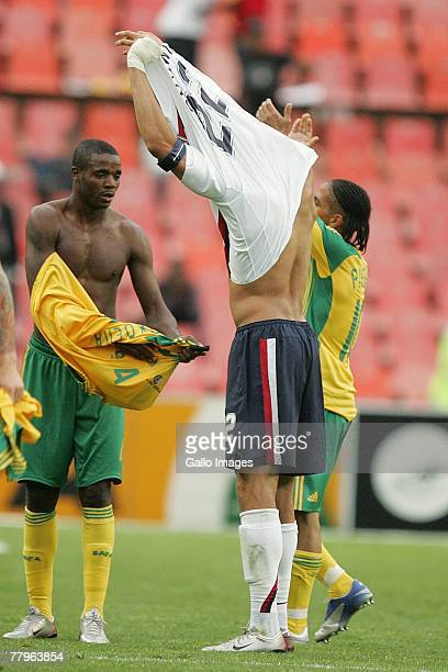 Aaron Mokoena of South Africa exchange jerseys with Carlos Bocanegra during the Nelson Mandela Challenge match between South Africa and United States...