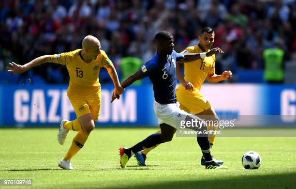 Aaron Mooy and team mate Andrew Nabbout of Australia put pressure on Paul Pogba of France during the 2018 FIFA World Cup Russia group C match between...
