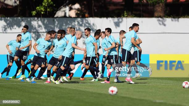 Aaron Mooy and team mates run during an Australia training session ahead of the FIFA Confederations Cup Russia 2017 on June 17 2017 in Sochi Russia