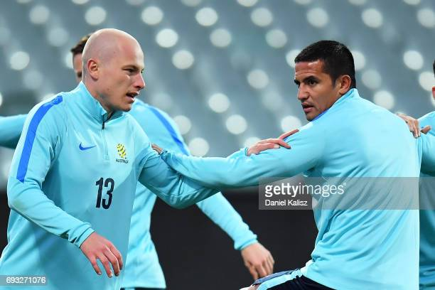 Aaron Mooy and Tim Cahill of Australia warm up during the Australian Socceroos training session at the Adelaide Oval on June 7 2017 in Adelaide...