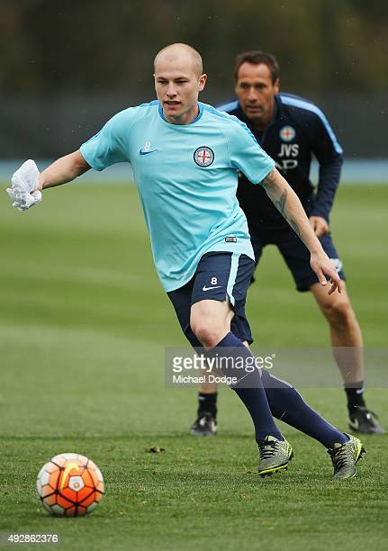 Aaron Mooy controls the ball in front of head coach John van't Schip during a Melbourne City FC training session at City Football Academy on October...