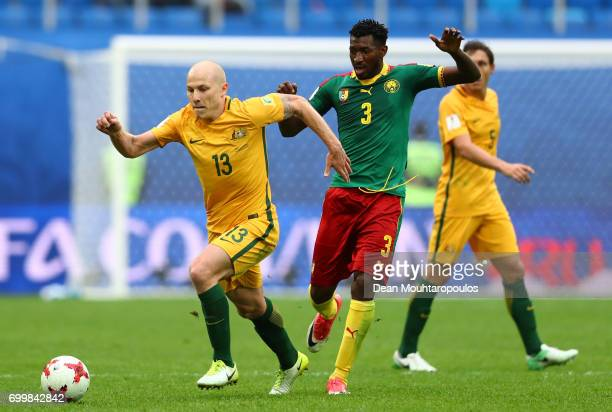Aaron Mooy of Australia and Andre Zambo of Cameroon battle for possession during the FIFA Confederations Cup Russia 2017 Group B match between...