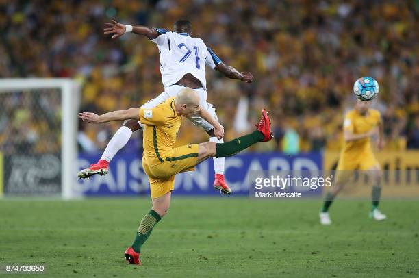 Aaron Mooy of Australia and Brayan Beckeles of Honduras compete during the 2018 FIFA World Cup Qualifiers Leg 2 match between the Australian...