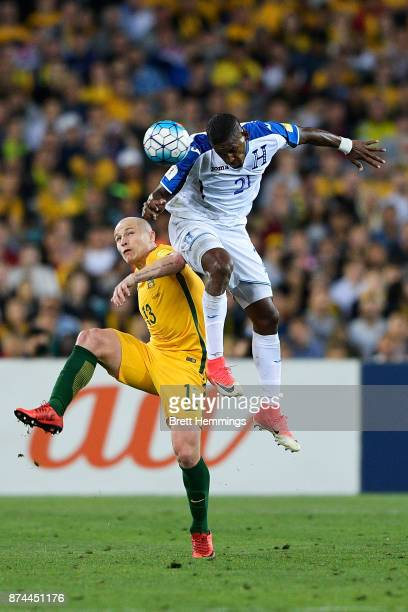 Aaron Mooy of Australia and Brayan Beckeles of Honduras contest a high ball during the 2018 FIFA World Cup Qualifiers Leg 2 match between the...